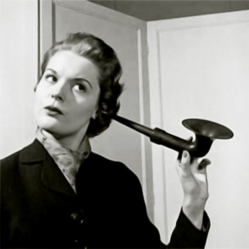 lady holding vintage ear horn black and white