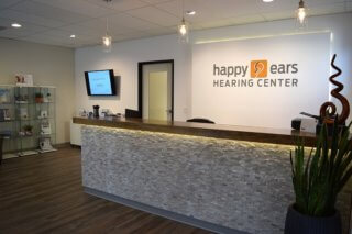 Hearing Aids Peoria AZ Check in view of Happy Ears modern lobby in Peoria Arizona