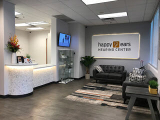 Hearing Aids AZ, Check in view of Happy Ears modern lobby